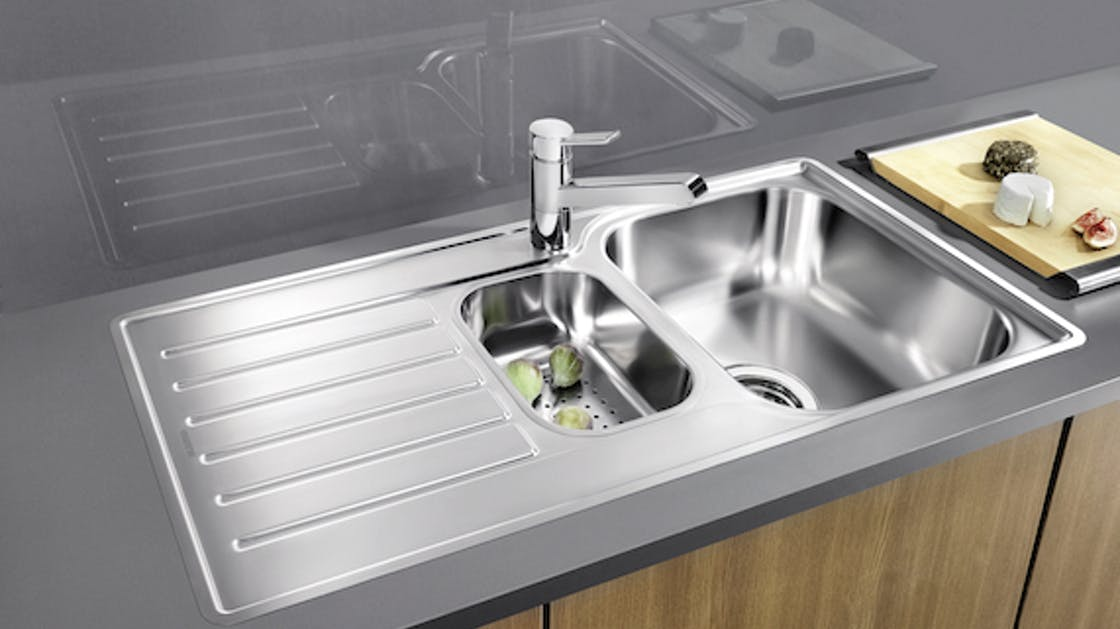 Stainless steel sink with gray worktop